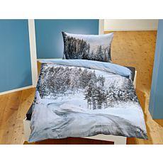 Linge de lit avec rue et paysage enneigés