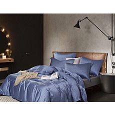 Linge de lit bleu orné d'un motif de parquet avec pois blancs