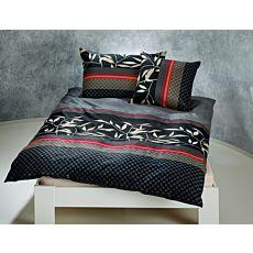 Parure de lit avec motif de feuilles sur fond noir rayé