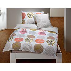 Parure de lit avec différents motifs de cercles et de fleurs