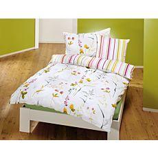 Parure de lit avec motif printanier de fleurs sur fond blanc