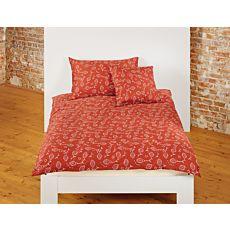 Linge de lit bio avec motif décoratif sur fond rouille