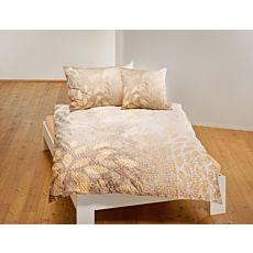 Parure de lit orné de feuilles et d'un subtil imprimé d'écorces dans des teintes automnales