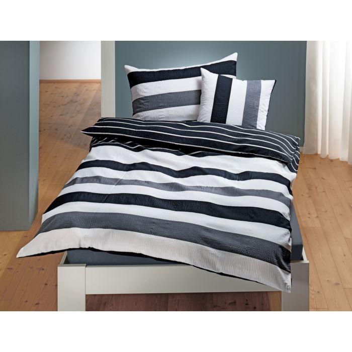 Parure de lit à rayures décoratives en noir et blanc