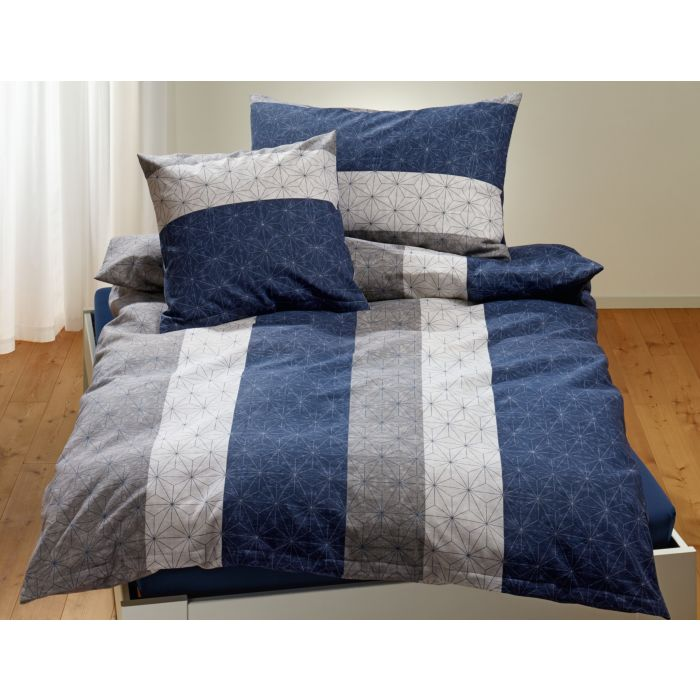 Parure de lit à bandes longitudinales et fin motif étoilé, dans les tons bleu et gris