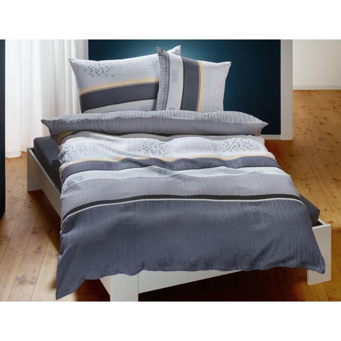 Parure de lit à rayures et à pois dans différents tons de gris