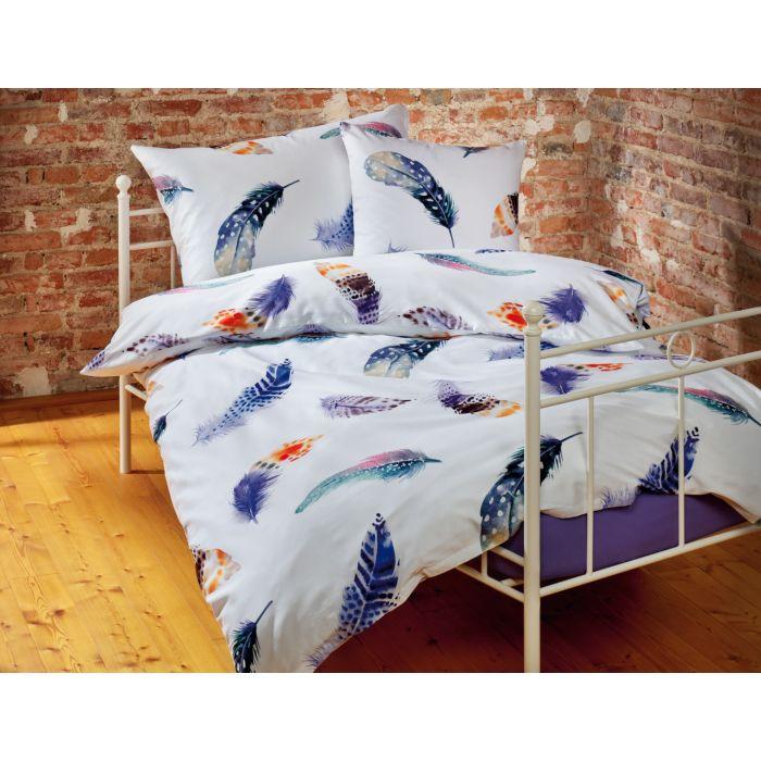 Parure de lit blanc avec plumes colorées