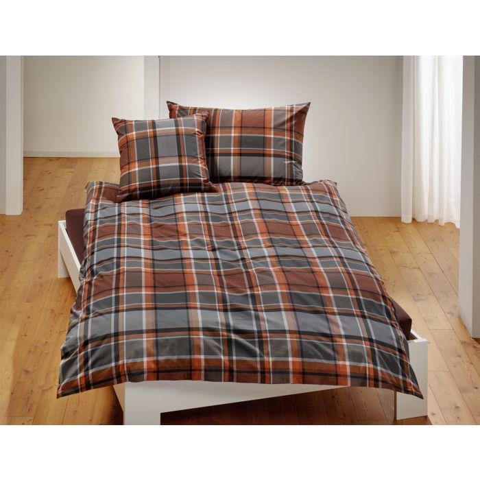 Parure de lit à carreaux dans des doux tons de brun et de gris